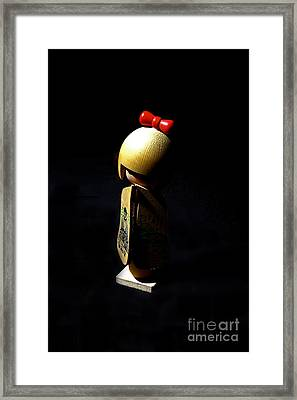 Framed Print featuring the photograph Kokeshi by Lawrence Burry
