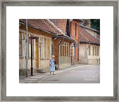 Kuldiga Street Crossing Framed Print