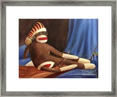 La Grande Sock Monkey Framed Print by Randol Burns