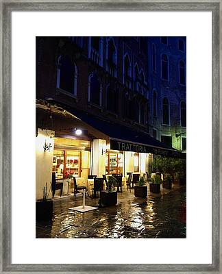 La Roberto's Trattoria On A Rainy Eve Framed Print by Jan Moore