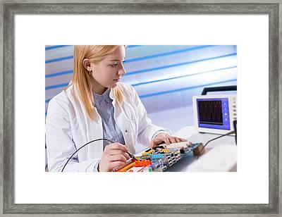 Lab Assistant Working On Circuit Board Framed Print by Wladimir Bulgar