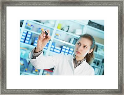 Lab Assistant Writing On Glass Framed Print