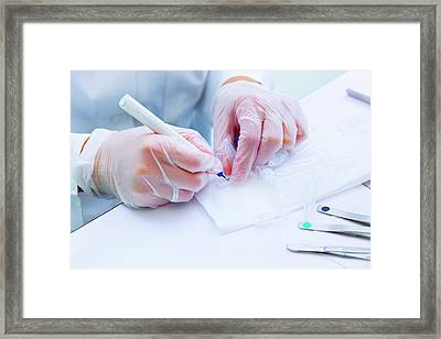 Lab Technician Writing On Test Tube Framed Print