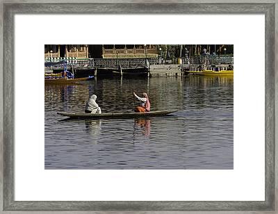 Ladies Plying A Small Boat In The Dal Lake In Srinagar - In Fron Framed Print by Ashish Agarwal