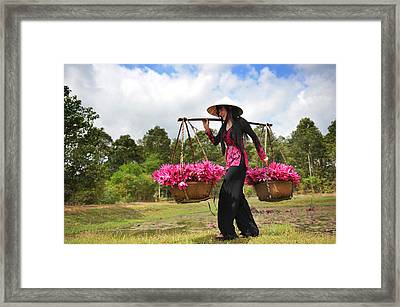Lady Caries Lotus Flowers Framed Print by Dung Ma