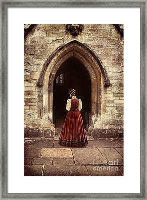 Lady Entering An Old Church Framed Print