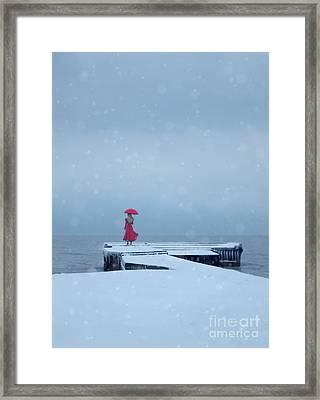 Lady In Red On Snowy Pier Framed Print by Jill Battaglia