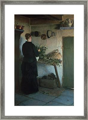 Lady In The Kitchen Framed Print by Viggo Johansen