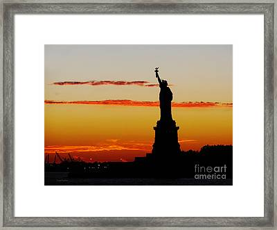 Framed Print featuring the photograph Lady Liberty At Sunset by Susan Wiedmann