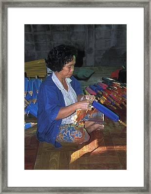 Lady Makes Umbrellas At A Factory Near Chaing Mai Framed Print by Richard Berry