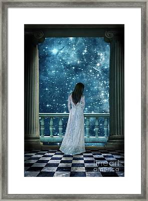 Lady On Balcony At Night Framed Print