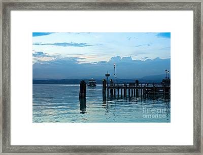 Lake Garda Pier And The Last Ferry For The Day Framed Print by Kiril Stanchev