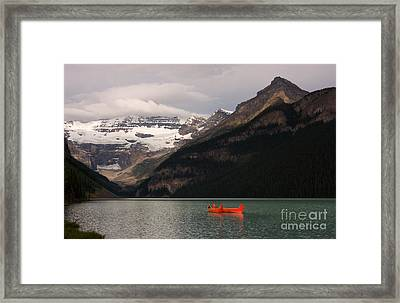 Framed Print featuring the photograph Lake Louise Canoes by Chris Scroggins