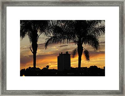 Lake Mirror Sunset Framed Print by Laurie Perry