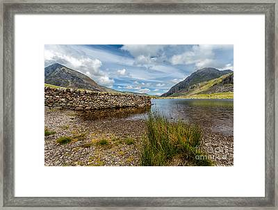 Lake Stone Wall Framed Print