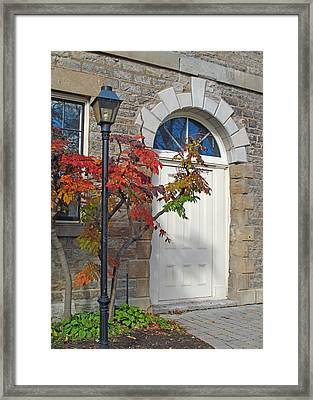 Lamp At The Doorway Framed Print