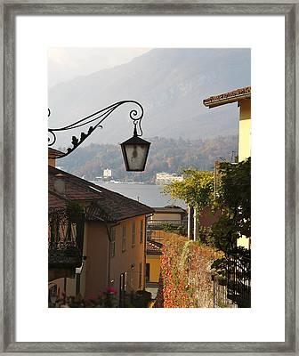 Lamp In Lake Como Framed Print by Rebecca Baker