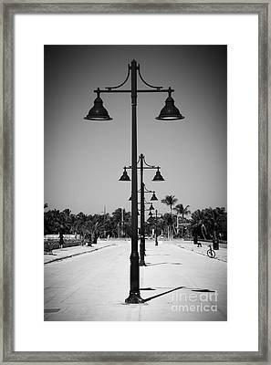 Lamp Posts White Street Pier Key West - Black And White Framed Print by Ian Monk