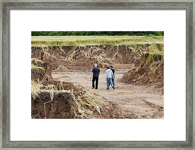Land Eroded By Flooding Framed Print by Ashley Cooper