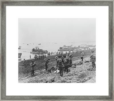 Landing Boats Unload Soldiers Onto Framed Print by Stocktrek Images