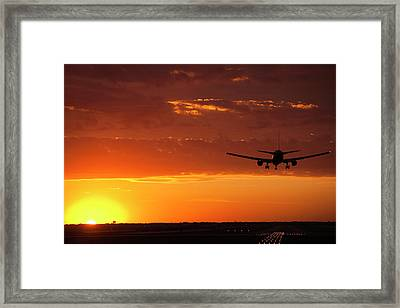 Landing Into The Sunset Framed Print by Andrew Soundarajan