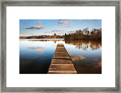 Landscape Of Fishing Jetty On Calm Lake At Sunset With Reflectio Framed Print by Matthew Gibson