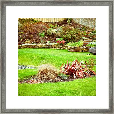 Landscaped Garden Framed Print by Tom Gowanlock