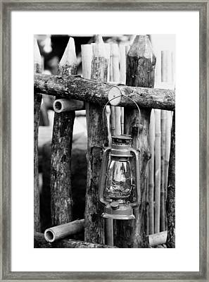 Lantern On Fence Framed Print