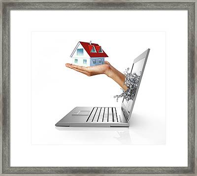 Laptop With Hand Holding Model House Framed Print by Leonello Calvetti