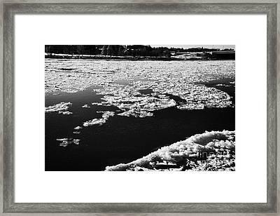 large chunks of floating ice on the south saskatchewan river freezing over in winter Saskatoon Saska Framed Print by Joe Fox