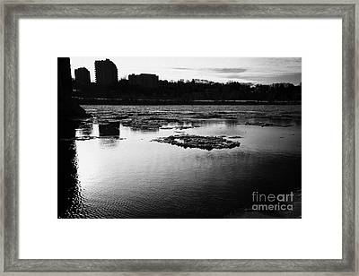 large chunks of floating ice on the south saskatchewan river in winter flowing through downtown Sask Framed Print