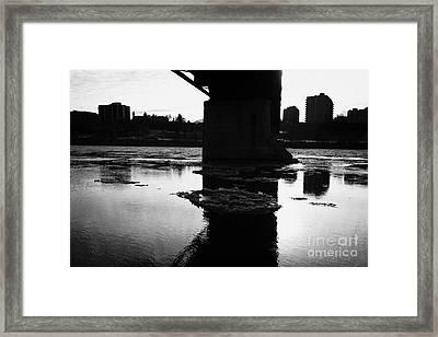 Large Chunks Of Floating Ice On The South Saskatchewan River In Winter Flowing Under Traffic Bridge  Framed Print by Joe Fox