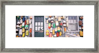 Large Group Of Buoys Hanging On A Framed Print