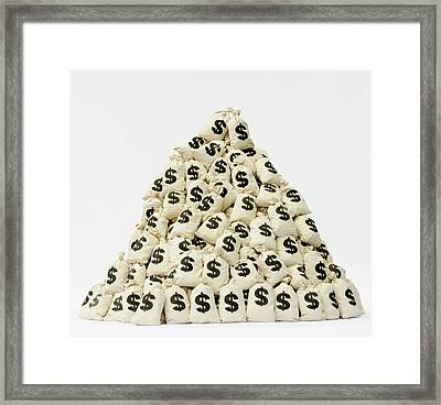 Large Pile Of Money Bags In A Pyramid Framed Print by Pm Images
