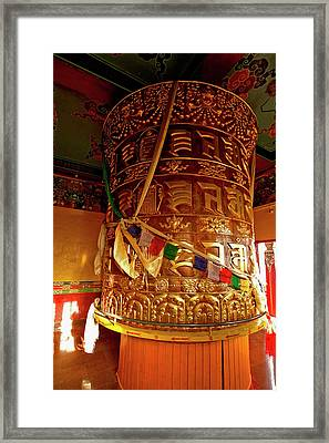 Large Prayer Wheel In A Buddhist Framed Print by Jaina Mishra