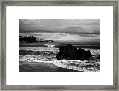 Large Rock On Ballycastle Beach In Winter County Antrim Northern Ireland Framed Print by Joe Fox