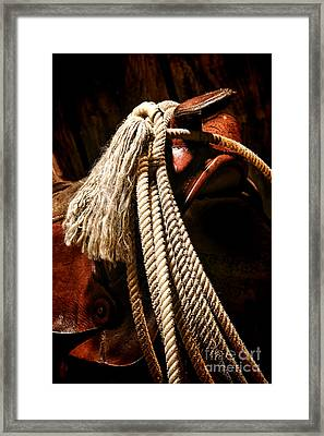 Lariat On A Saddle Framed Print by Olivier Le Queinec