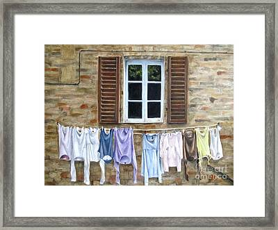Laundry Day In Tuscany Framed Print by Karen Olson