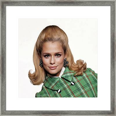 Laura Hutton Wearing A Coat And Earrings Framed Print by Bert Stern