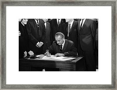 Lbj Signs Civil Rights Bill Framed Print by Underwood Archives Warren Leffler
