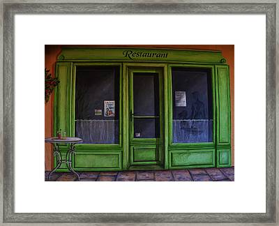 Le Restaurant Framed Print by Dany Lison