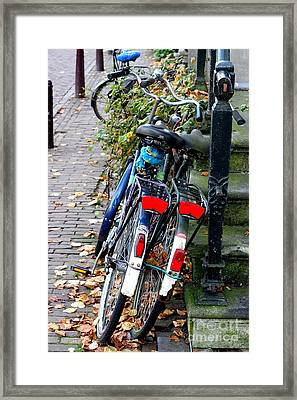 Leaning Bicycles Framed Print