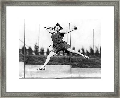 Leaping Tennis Woman Framed Print by Underwood Archives