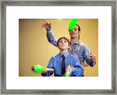 Learning To Juggle Framed Print by Jim West