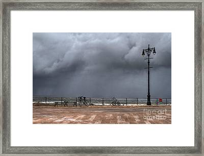 Left In The Power Of The Storm Framed Print by Evelina Kremsdorf