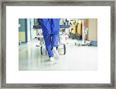 Legs Of Medic Running With Gurney Along Framed Print by Phil Fisk