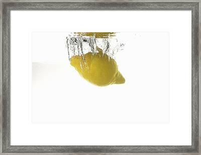 Lemon Splashing Underwater Framed Print by Sami Sarkis