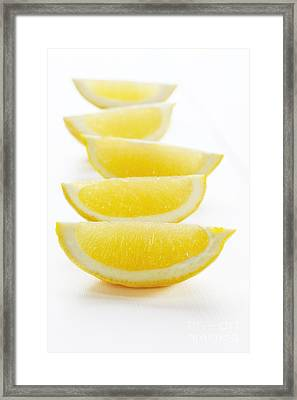 Lemon Wedges On White Background Framed Print by Colin and Linda McKie