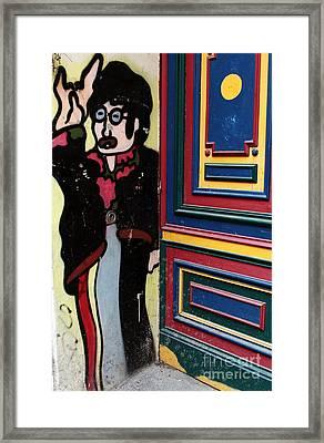 Lennon In Berlin Framed Print