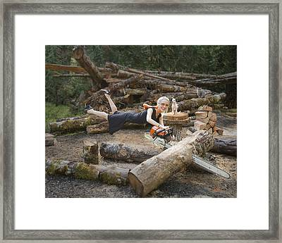 Levitating Housewife - Cutting Firewood Framed Print by Lori Grimmett